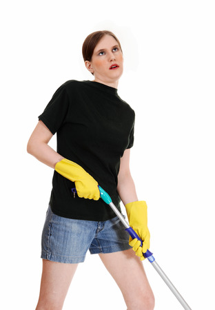 A young woman in shorts and yellow rubber cloves is tired of cleaningfloor