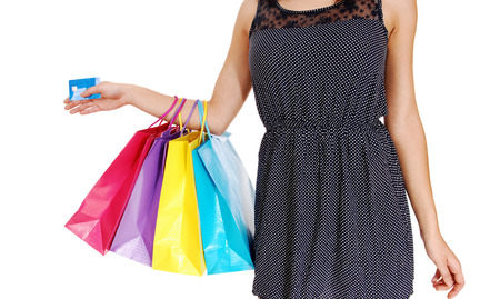 A young woman holding her shopping four bag photo