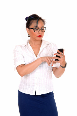A lovely Asian business woman with her phone in her hand, texting, isolatedfor white background  photo