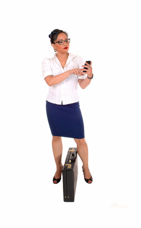 A lovely Asian business woman with a cell phone in her hand dialling her phone number, isolated for white background  photo