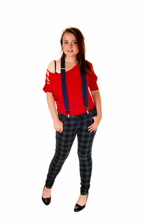 suspender: A beautiful young teenager girl in green blue pants and a red sweater andblue suspender standing isolate for white background.