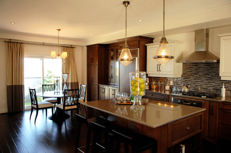 A beautiful spaces dining room in a model home in Ottawa, Canada witha wooden floor.