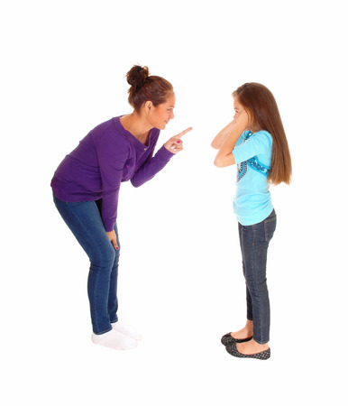 A mother is disciplining her young daughter and the girl holding herears closed, isolated for white background. Imagens