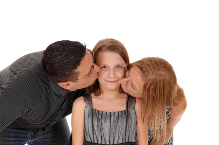 A closeup picture of a couple kissing there young daughter on thechick, isolated for white background. photo