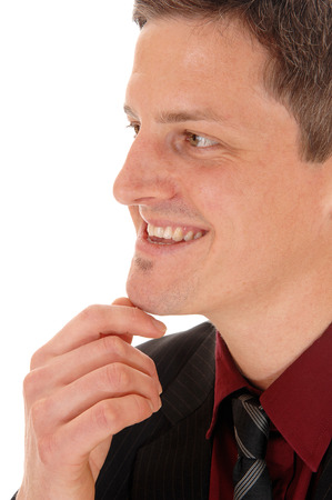 A closeup face shoot of a young smiling man in a burgundy shirt, isolatedfor white background. photo