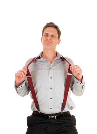 suspender: A happy smiling young man in a grey shirt with red suspender sittingIsolated for white background.