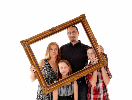 A young lovely family standing for white background and holding apicture frame in front of them. photo