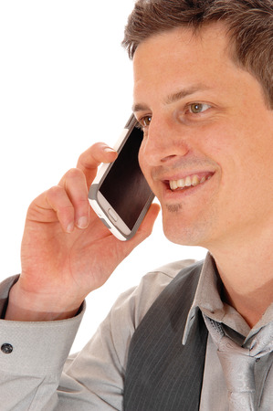 A closeup picture of the face of a man talking on his cell phone,isolated for white background. photo