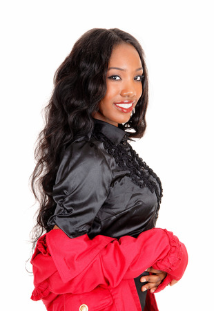 A  closeup picture of a pretty African American woman in a black blouseand red jacket, smiling for white background. photo