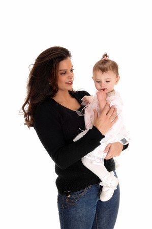 A young mother holding her daughter in her arms, isolated forwhite background. photo