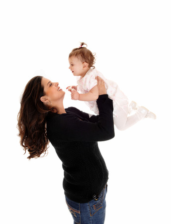 whitebackground: A mother lifting up her daughter baby, standing isolated for whitebackground.