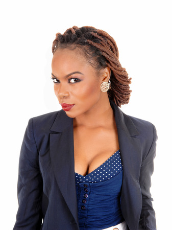 A closeup portrait of a pretty African American women in a dark blue jacketand braided hair standing isolated for white background.