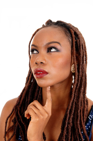 A beautiful young African American woman with long braided brown hair,with one finger under her chin, isolated for white background. photo