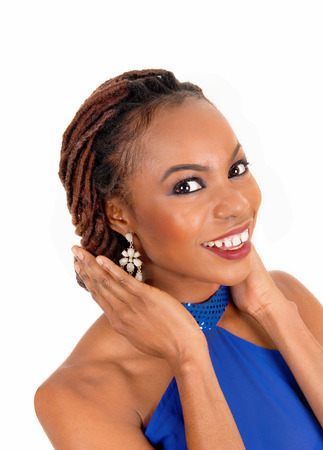 A portrait of a lovely African American woman smiling with her hands onher face, isolated for white background. photo