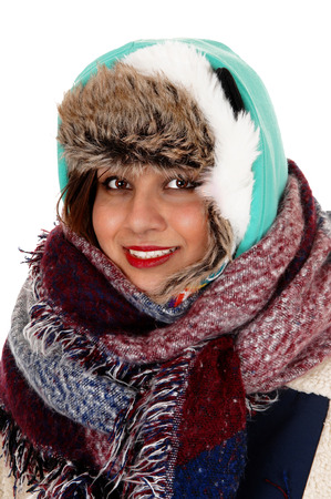 very cold: A lovely young woman with a big scarf around her neck and head,dressed for very cold weather, isolated for white background. Stock Photo