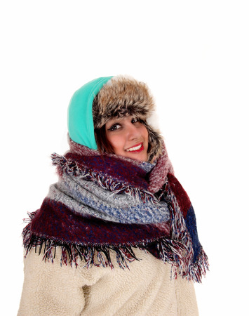 very cold: A portrait picture of a woman with a big scarf around her neck and head,dressed for very cold weather, isolated for white background.