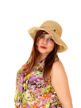 A portrait shot of a serious looking young woman wearing a straw hat and blousewith her hand behind her head, isolated for white background. photo