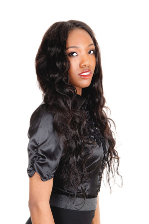 A lovely African American woman in a black blouse and long black curlyhair, isolated for white background. photo