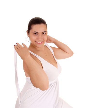 taking off: A lovely smiling young woman taking off her white dress, isolated for white background.