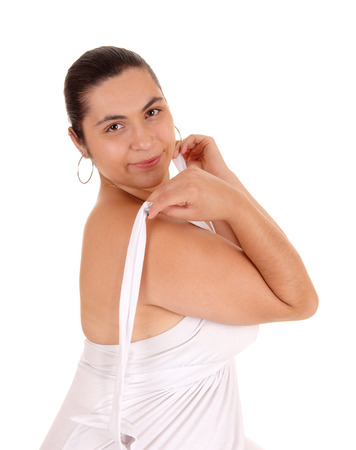 getting dressed: A beautiful young woman getting dressed with her white dress, smiling, isolated for white background.