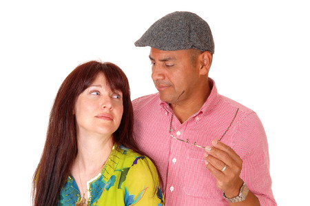 middle age couple: A closeup picture of a middle age couple standing insolate for white background looking at each other.