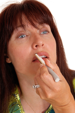 putting lipstick: A middle are woman applying makeup and putting lipstick on, in closeup,  isolated for white background.