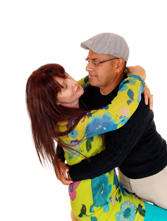 middle age couple: A very happy middle age couple having fun together and hugging, isolated for white background. Stock Photo