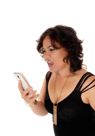mixed raced: A angry young mixed raced woman holding her cell phone and shouting at it, isolated for white background.
