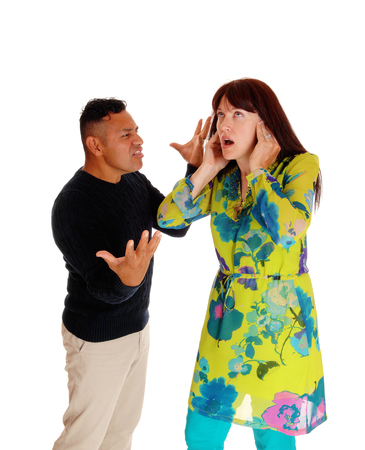 man yelling: An Hispanic man yelling at his Caucasian wife, domestic violence, isolated for white background.