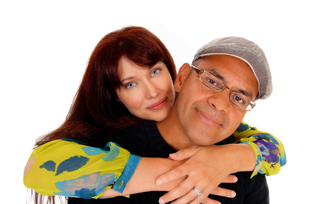 middle age couple: A closeuo photo of a happy middle age couple, the wife is hugging her husband from behind, isolated for white background.