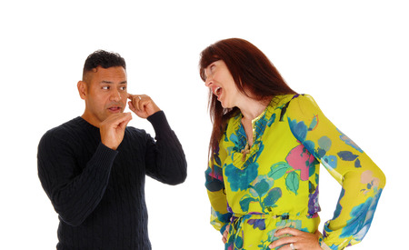 A closeup picture of a woman yelling at her husband and he is scared, domestic violence, isolated for white background.