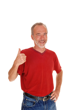 thump: A smiling middle aged man standing isolated for white background in a red t-shirt with one thump up.