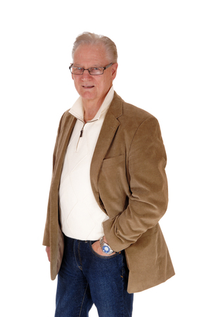 aged: A good looking middle age man standing in jeans and a brown jacket isolated for white background.