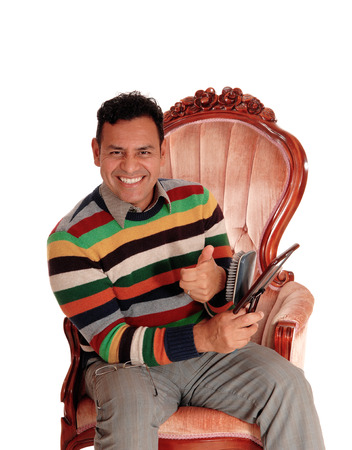 thump: A smiling Hispanic man is happy after he finished coming his short black hair giving the thump up, isolated for white background.