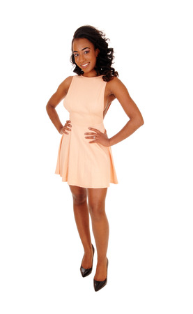 sexy woman standing: A full body image of a african american women with her hands on her hips standing in front, isolated for white background. Stock Photo
