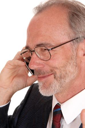 business for the middle: A middle age smiling business man talking on his cell phone, in a closeup image, isolated for white background. Stock Photo