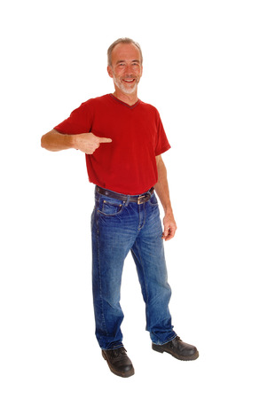 stupid body: A smiling middle age man in jeans and red t-shirt standing isolated for white background and pointing at himself. Stock Photo