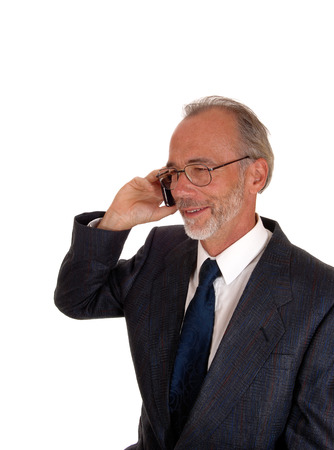business for the middle: A middle age smiling business man in a suit, talking on his cell phone, isolated for white background. Stock Photo