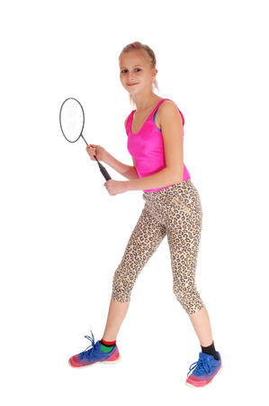 tights: A beautiful little girl holding her tennis racquet in her hand in a pink bathing suit and tights, isolated for white background.