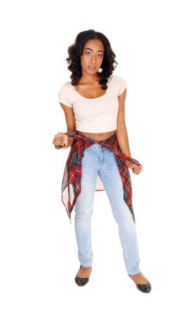 A full body image of a African American women in jeans and beige top