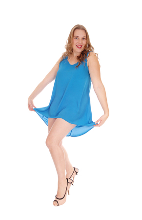 blue dress: A beautiful young woman dancing in a short blue dress, isolated for white background.