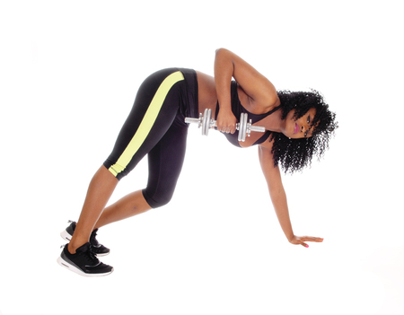 american sport: A beautiful African American girl working out with on dumbbell in exercise outfit Stock Photo