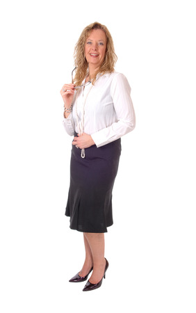 business for the middle: A middle age business woman in a black skirt and white blouse standing isolated for white background.