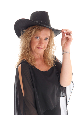waist up: A beautiful blond and happy woman in a black dress standing waist up with a black hat, isolated for white background.