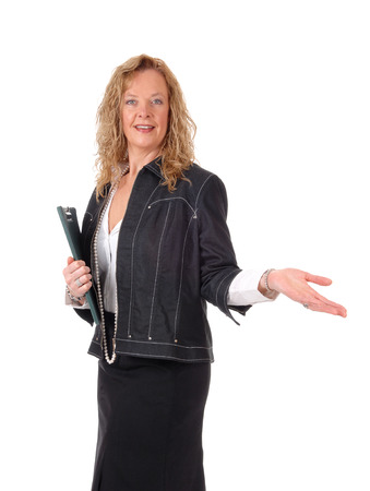 business for the middle: A middle age business woman in a black skirt and navy jacket standing with a outstretched hand, isolated for white background. Stock Photo