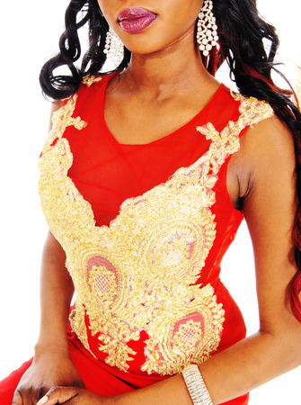 red evening: An African American woman standing in a red evening dress with gold embroideries and long black hair isolated for white background.