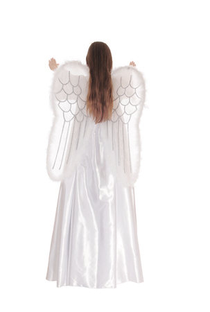 satin dress: An angel in a long white satin dress with wings and long brown hairstanding from the back with arms raised isolated for white background.