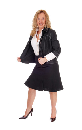 business for the middle: A middle age business woman in a black skirt and navy jacket standing isolated for white background.