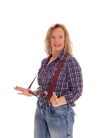 waist up: A meddle age woman in checkered shirt and jeans and red suspenders standing waist up isolated for white background. Stock Photo