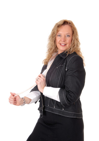 business for the middle: A middle age business woman in a black skirt and navy jacket standing from waist up, isolated for white background.